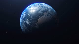 Earth 1023: Planet Earth rotates in space from day into night and city lights turn on (Loop).