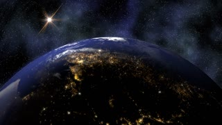 Planet Earth rotates in space from day into night and city lights turn on (Loop).