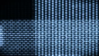 Television screen pixels fluctuate with video motion (Loop).