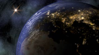 The Planet Earth in space as night falls over Europe and North America and city lights turn on.