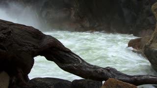 Waterfall 0312: A waterfall gushes through big rocks into a pool (Loop).