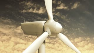 Wind Turbine 102: A windmill wind turbine turns on golden time lapse clouds (Loop).