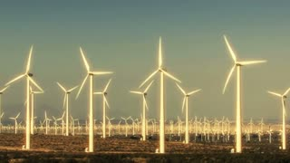 Wind Turbine 3020: Wind turbines turn against a blue sky.