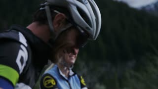 Close up of couple in biking gear talking to one another