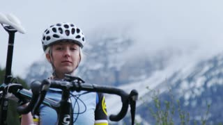 Close up of girl holding road bike
