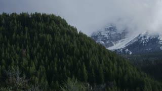 Close up of man road biking through mountains