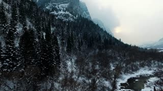 drone shot of snow covered mountains