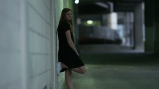 girl in alley way stares down camera