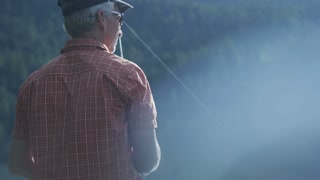 Man fishing in the mountains