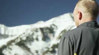 man looking at mountain view