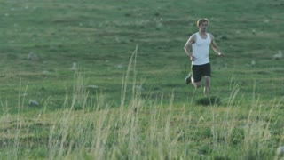 Man running through desert landscape