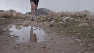 mans legs while running on trails
