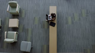 overhead shot of woman on lap top