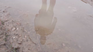 reflection of man through puddle
