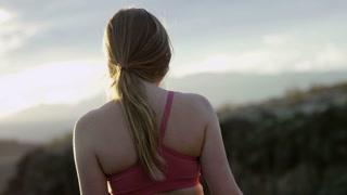 slow motion close up of girl staring at sun set