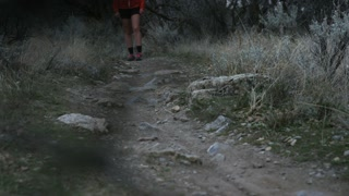 close up of legs running on trail