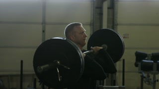 Slow motion man exercising with weights