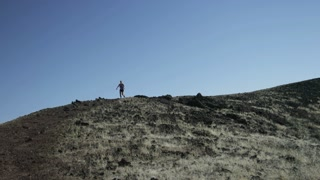 slow motion woman running downhill on trail