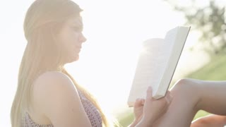 sunflare with woman reading book