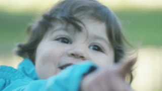 close up of little girl pointing and giggling