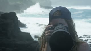 close up of woman taking photos at the beach