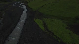 Drone shot following Icelandic river