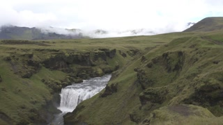 Icelandic landscape with lush greenery and waterfalls