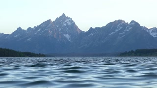 landscape of Grand Tetons with water rippling in foreground