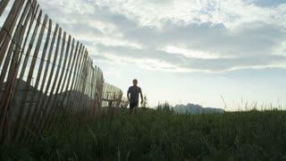 man runs on trail towards camera near Alta, Utah