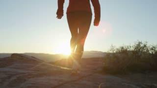woman running towards sunset