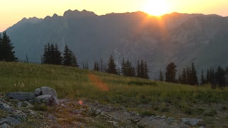 woman runs through trail in the mountains at sunset in Utah's Wasatch Range