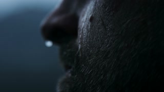 water dripping down mans face