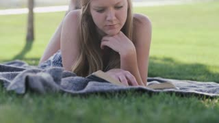 woman outside reading book