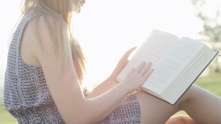 woman reading book lays down