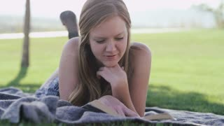 Woman reading in the park in the summertime