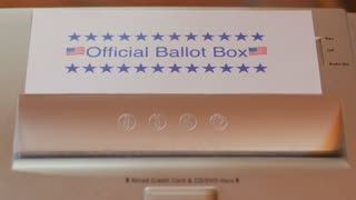 A ballot marked with Hillary Clinton for president is fed into a paper shredder that is labeled as the Official Ballot Box to signify voter fraud or stealing the election