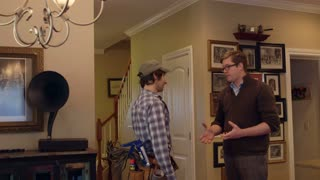 A contractor and home owner shake hands inside a house as they agree on a project