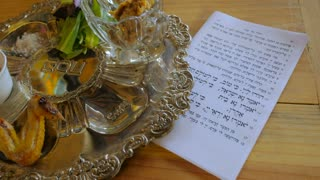 A hand puts the finishing touches on a passover seder plate - dolly