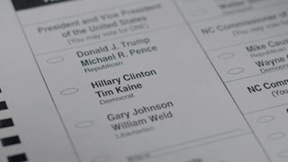 A voter's ballot is crumbled up while voting for Hillary Clinton during the 2016 general presidential election
