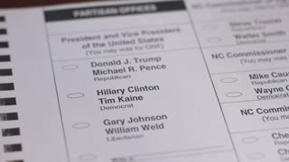Close up a voter voting for the democrat Hillary Clinton and Tim Kaine with a black pen during the 2016 General Presidential Election