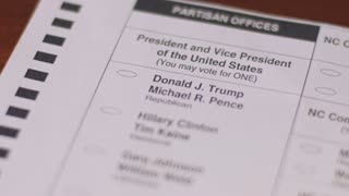 Close up a voter voting for the Republican Donald Trump and Michael Pence with a black pen during the 2016 General Presidential Election