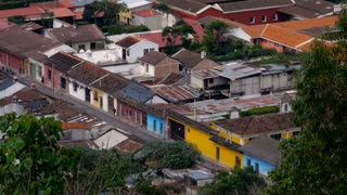 Establishing wide shot of eople walking down the colorful streets of Antigua shot from above in this beautiful Central American UNESCO World Heritage Site