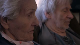 Hand held of two senior adults (a son and his elderly mother) having an intimate conversation - close up 4k