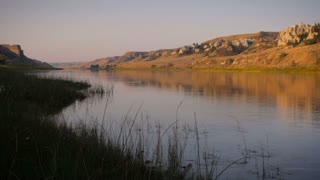 Lock down shot of the Missouri River in Montana at sunrise along the Lewis and Clark national historic trail monument