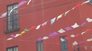 Plastic flags or banners blowing in the wind in San Miguel de Allende, Mexico in slow motion