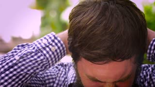 Portrait of a bearded man pulling his hair out in disgust and frustration