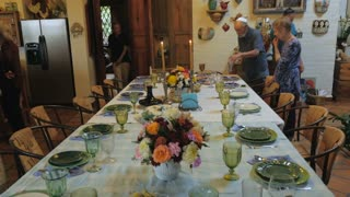 Push in of a dinner table as guests arrive to a passover seder or dinner party.