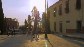 SAN MIGUEL DE ALLENDE, MEXICO - CIRCA MAY 2016 - Slow motion of school aged children and families walking in a plaza in Mexico