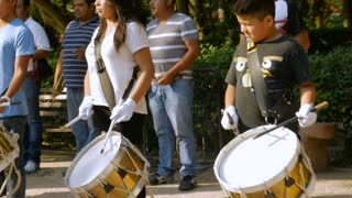 SAN MIGUEL DE ALLENDE, MEXICO - CIRCA MAY 2016 - Young band members practice their drums in Benito Juarez park in slow motion.
