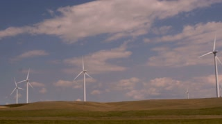 Slow motion driving shot of wind turbines on a wind farm in Montana